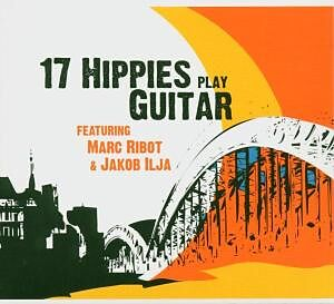 17 Hhippies Play Guitar